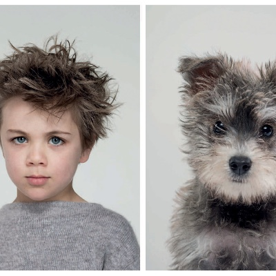 A boy who looks like his dog (or a dog who looks like his boy).