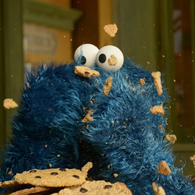 Cookie Monster in a whirlwind of cookie consumption.