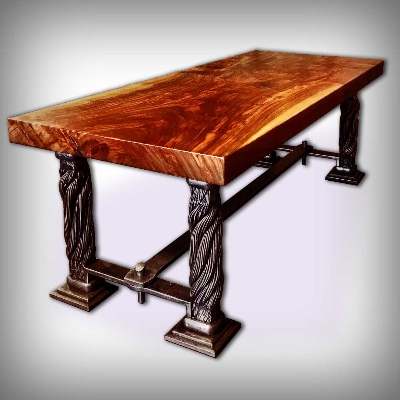 A table with a thick wooden top and legs made from actual Golden Gate Bridge suspender ropes.